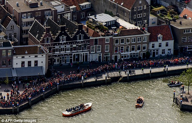 Throng: Huge crowds turned out to see the royal barge drift past