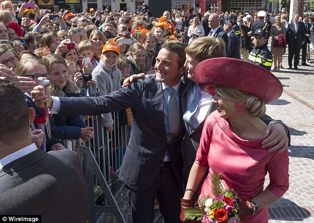 A right royal selfie! A well-wisher snaps a selfie with the Dutch King and Queen