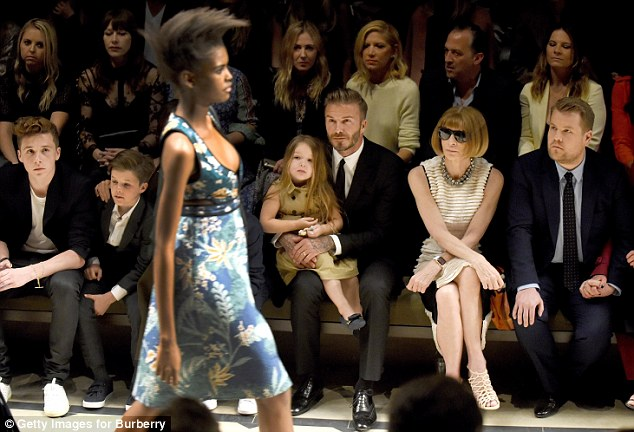The most powerful woman in fashion: Vogue US Editor Anna Wintour, pictured here between David Beckham (left with daughter Harper) and James Corden (right) in LA on April 16 remains ever influential