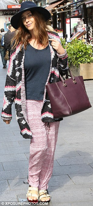 Boho chic: The star stepped out in an oversized, Aztec-patterned cardigan, teamed with baggy trousers