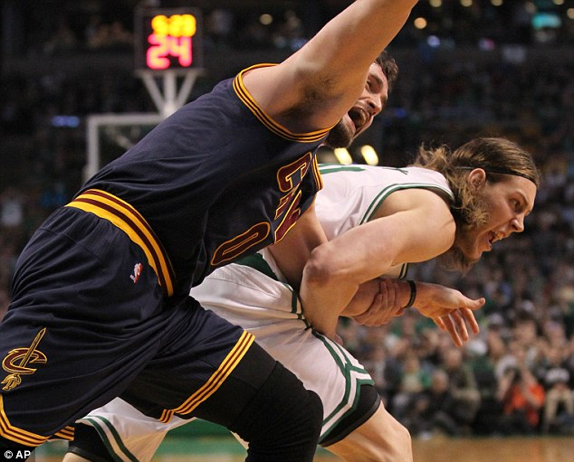 Photos appeared to show that Love was dragged by the arm by Boston Celtics center Kelly Olynyk during the first quarter resulting in an injury that forced the Cavaliers forward from the game