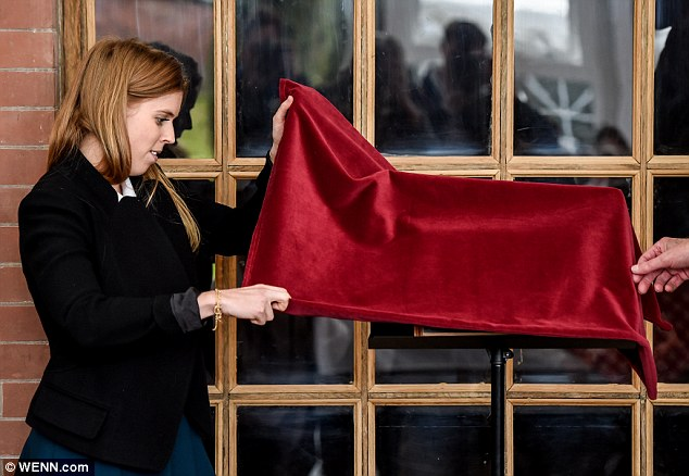 Ready: Beatrice whips the covering off a commemorative plaque