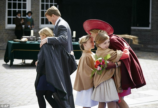 Big hug: Queen Maxima hugs her two youngest daughters, Princesses Ariane and Alexia