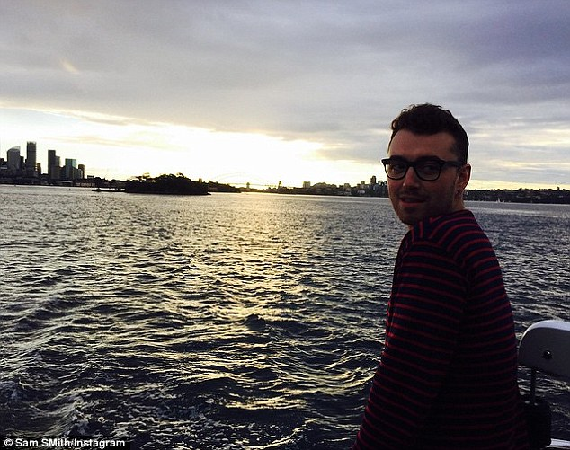 'Home': The singer also shared a shot to Instagram on Sunday of himself on a boat with the Sydney skyline in the background and simply captioned the shot: 'Home x.'