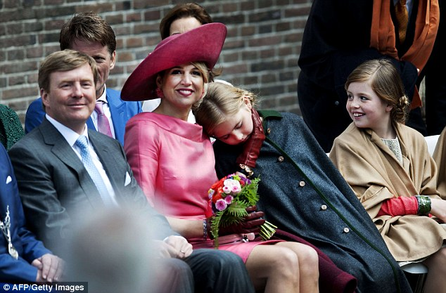 Is that it? Eldest daughter Princess Catharina-Amalia, 11, cuddles up to her mother during the event
