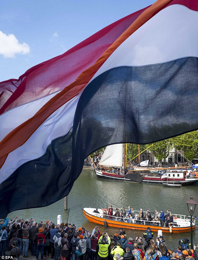 Patriotic: Dutch flags were flying all over the town while many revellers came dressed in patriotic orange
