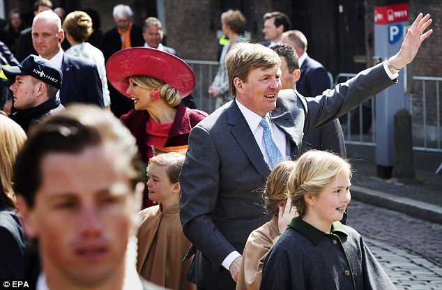 Royal wave: King Willem-Alexander waves at the crowds during a walk through the city with his children