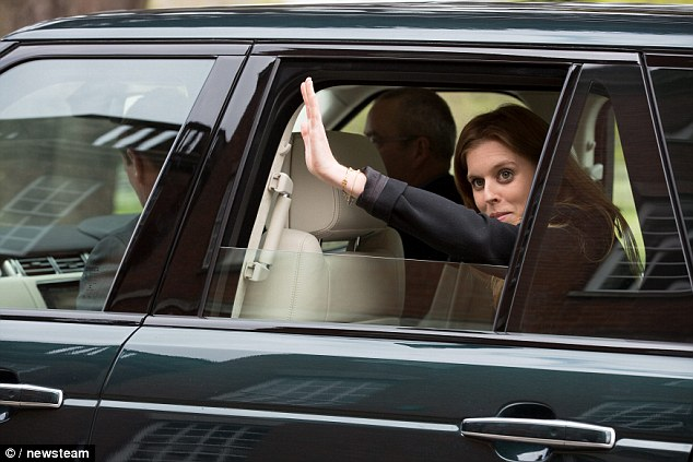 Job done! The Princess waved to students and staff as she was driven away from the school