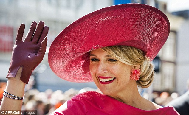 Matching: The Dutch queen completed her look with a slick of bright pink lipstick and chunky earrings
