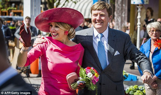 Warm welcome: The Dutch royal couple were all smiles as they meet well-wishers in the trading city