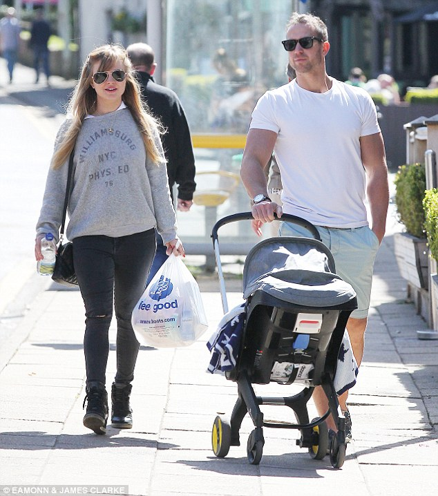 Family day: Tina O'Brien enjoyed a relaxing Sunday afternoon in Alderley Edge, Cheshire with her fiance Adam Crofts and their six-month-old son Beau