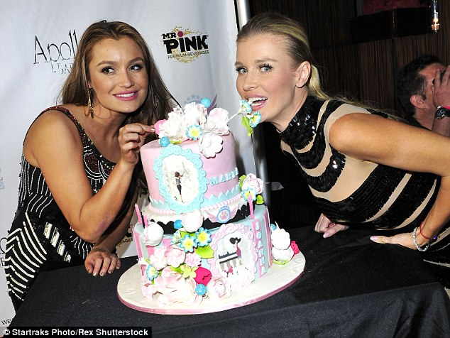 Impressive: The elaborate cake was presented to the pretty sisters