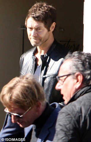 Looking good: Heart throb Howard Donald followed closely behind Mark as they arrived by private jet