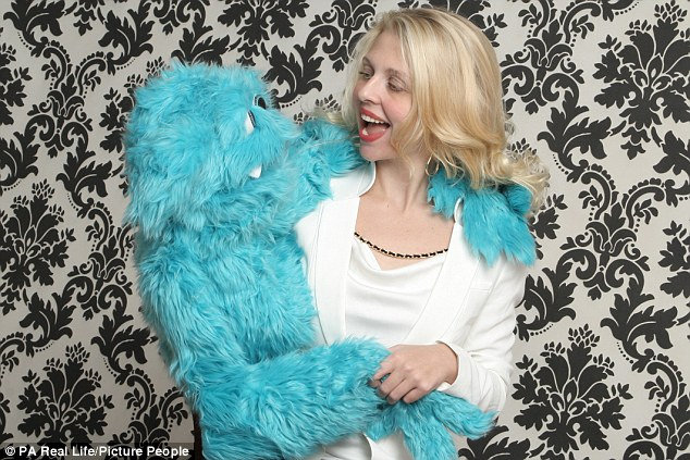 April Brucker pictured with her puppetMortimer - one of the 16 she considers to be her children