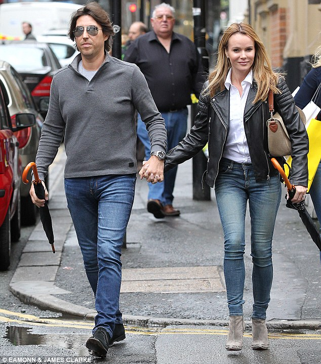 Low-key outing: She dressed her slender frame in tight denim pants and a black leather jacket, while her partner looked coordinated in jeans and a grey jumper during their lunch date in Manchester
