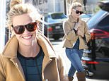 Reese Witherspoon leaves the spa in brown boots, cute shades and swing coat with a huge grin. Monday, November 16, 2015. X17online.com