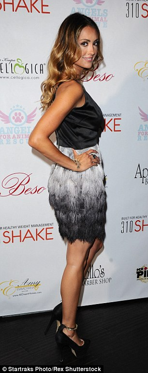 Katie wore a feathered skirt which tiered from grey to black