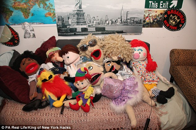 April's 'children' - her 16 puppets which live with her in her apartment in New York
