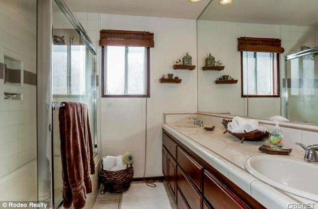 The bath: His-and-her sinks and a glass shower doors are featured in the bathroom