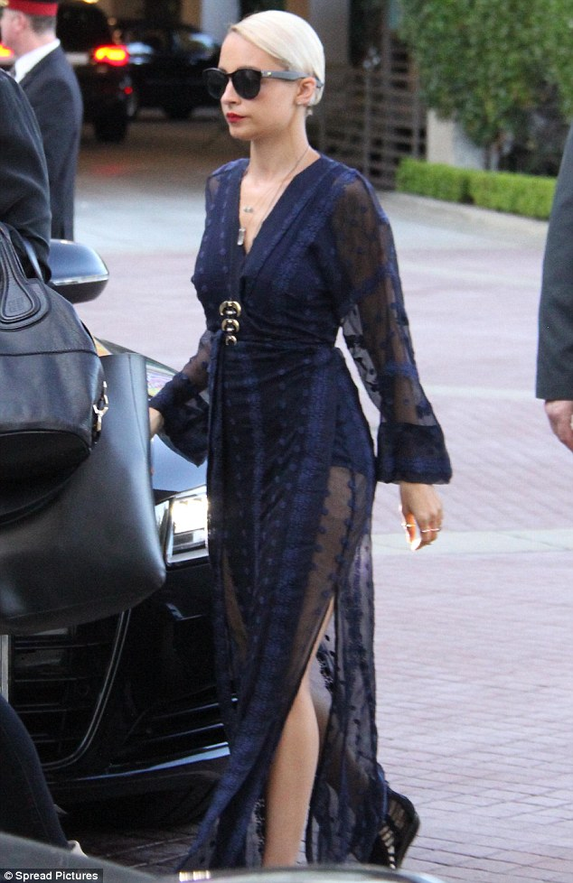 Chic: The mother-of-twohighlighted her lean legs through the thigh-high side slits of her lace and chiffon dress
