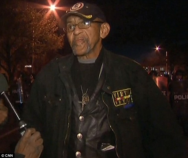 Robert Valentine (right) identified himself as 'just a solider' during an interview he did with CNN in Baltimore