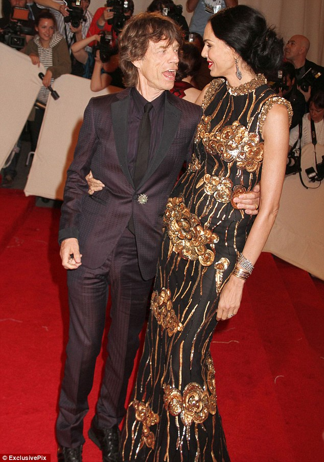 Difficult times: Jagger, pictured here with the fashion designer at the Savage Beauty Costume Institute Gala, has returned to the Zip Tour with The Rolling Stones