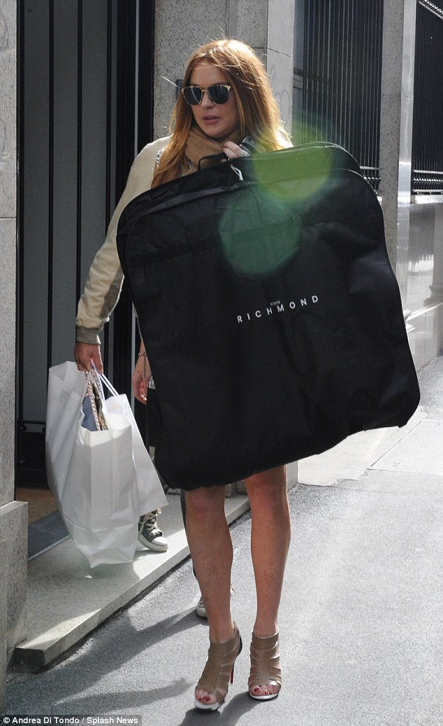 T'il you drop: Lohan threw a jacket over the outfit and took to the streets, where she spotted plenty of items