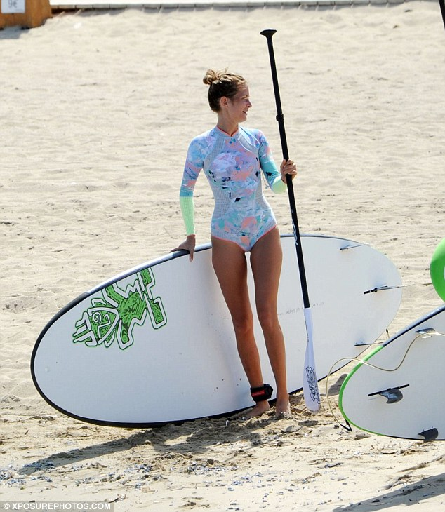 Showing her shape: Millie has been proud to show off her impressive swimwear collection