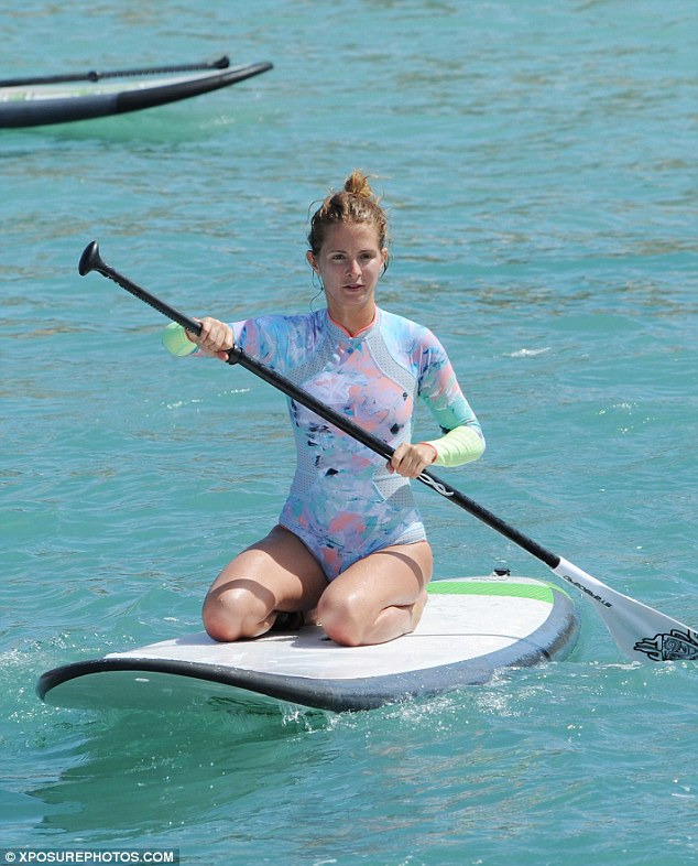 Hassle free: The starlet wrapped her hair into a fuss-free top knot for ease in the water