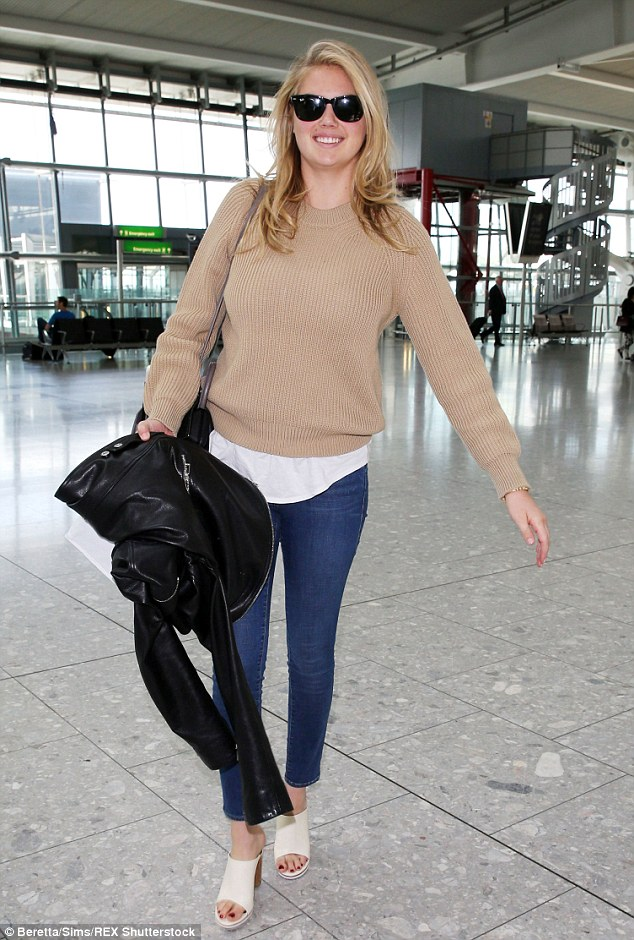 Natural beauty: Make-up free Kate Upton wears a caramel coloured jumper with skinny Frame Denim jeans and cream mules as she jets out of Heathrow on Tuesday