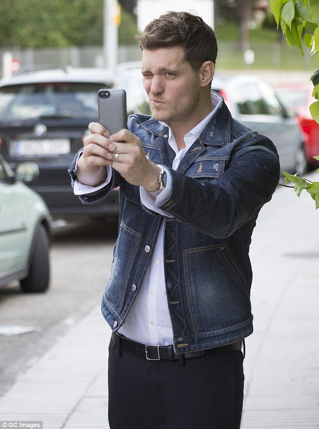 Selfies only from now on:Michael Bublé was recently accused of body-shaming a woman while on holiday with his wife and 19-month-old son Noah, in Miami, Florida so wisely stuck to selfies in Madrid on Tuesday