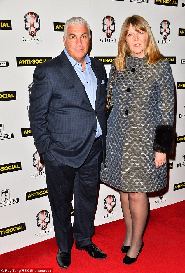 Showing his support: Mitch Winehouse and his wife Jane stepped out in support of his late daughter Amy's boyfriend Reg Traviss on Tuesday night as he premiered his new film Anti-Social in London