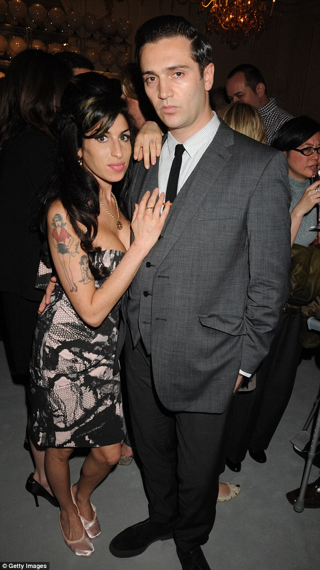 Lost love: Pictured here together in June 2010, Reg, like Mitch, lost his love Amy to alcohol poisoning in July 2011