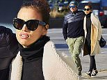EXCLUSIVE: Bradley Cooper spotted holding supermodel girlfriend Irina Shayk close as they stay warm during a crisp Autumn afternoon in NYC   Pictured: Bradley Cooper, Irina Shayk, Ref: SPL1176800  151115   EXCLUSIVE Picture by: J. Webber / Splash News  Splash News and Pictures Los Angeles: 310-821-2666 New York: 212-619-2666 London: 870-934-2666 photodesk@splashnews.com