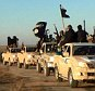 """Militants of the Islamic State group hold up their weapons and wave its flags on their vehicles in a convoy on a road leading to Iraq, while riding in Raqqa city in Syria.   The Islamic State group is notorious for the atrocities it committed as it overran much of Syria and neighboring Iraq. But to its supporters, it is engaged in an ambitious project: building a new nation ruled by what radicals see as """"God's law,"""" made up of Muslims from around the world whose old nationalities have been erased to unite in the """"caliphate.""""     In this undated photo released by a militant website, which has been verified and is consistent with other AP reporting. (Militant website via AP)"""