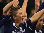 Anderlecht players and fans celebrate after beating Tottenham Hotspur 2.1