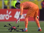 Uruguayan goalie Fernando Muslera picks up a drone that fell on the field during their Russia 2018 FIFA World Cup South American Qualifiers football match against Ecuador, in Quito, on November 12, 2015.    AFP PHOTO / RODRIGO BUENDIARODRIGO BUENDIA/AFP/Getty Images