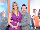 WESTWOOD, CA - JULY 27:  Actor David Faustino (R) and Lindsay Bronson arrive at the Premiere Of Warner Bros. 'Vacation' at Regency Village Theatre on July 27, 2015 in Westwood, California.  (Photo by Barry King/Getty Images)