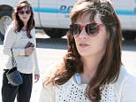 145008, EXCLUSIVE: Zooey Deschanel bundles up as she goes out and about in LA, while her husband Jacob Pechenik seems impervious to the windy weather on a  shirtless bike ride.  Los Angeles, California- Sunday November 15, 2015. Photograph: © KVS, PacificCoastNews. Los Angeles Office: +1 310.822.0419 sales@pacificcoastnews.com FEE MUST BE AGREED PRIOR TO USAGE