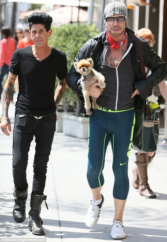 Man's other best friend: Mickey was accompanied on his outing by his faithful sidekickGiuseppe Franco