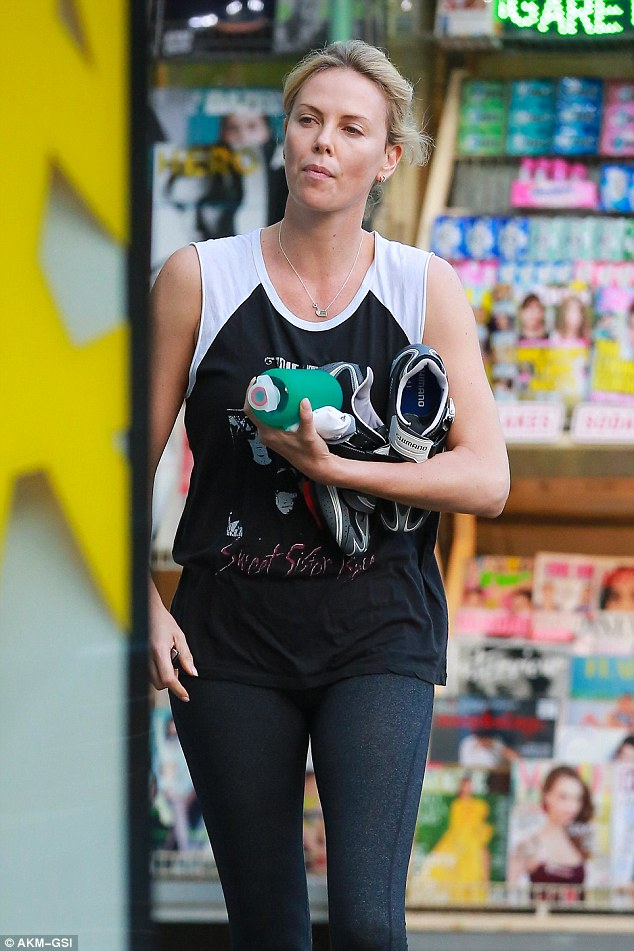 Exercising away her woes: Charlize Theron was seen for the first time since her reported split with Sean Penn on Friday as she made a stop at a gas station in Hollywood