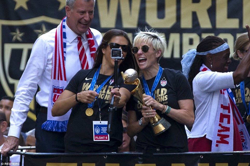 Rapinoe and Lloyd seemed more concerned with getting the Wold Cup trophy in a selfie than they were with capturing Mayor  de Blasio