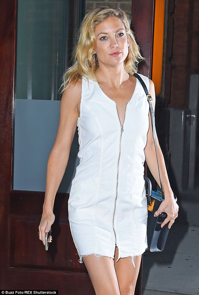 Prepared: The romcom queen kept her phone at hand as she strolled around the city