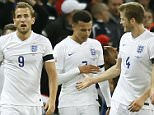 Englandís Dele Alli, second left, celebrates with teammates after scoring the opening goal during the international friendly soccer match between England and France at Wembley Stadium in London, Tuesday, Nov. 17, 2015. France is playing England at Wembley on Tuesday after the countries decided the match should go ahead despite the deadly attacks in Paris last Friday night which killed scores of people. (AP Photo/Kirsty Wigglesworth)