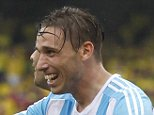 Argentina's Lucas Biglia celebrates with teammate8 Ezequiel Lavezzi after scoring against Colombia  during a 2018 World Cup qualifying soccer match in Barranquilla, Colombia, Tuesday, Nov. 17, 2015. (AP Photo/Martin Mejia)
