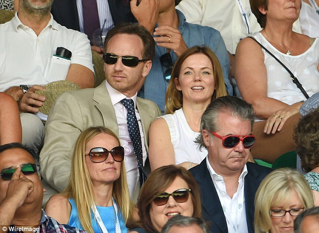 Looking cosy: Geri practically sat on top of her handsome man as the two sat centre court for the match