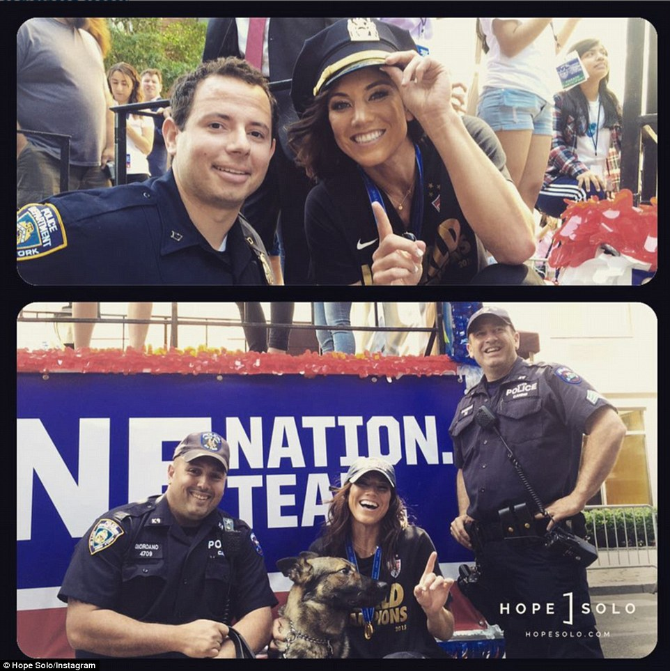 Solo was celebrating with a few of New York City's finest officers and a K-9 cop during the parade. She also scored a new hat (above)