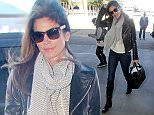 UK CLIENTS MUST CREDIT: AKM-GSI ONLY EXCLUSIVE: Los Angeles, CA - Cindy Crawford looks flawless as usual as she arrives at LAX and signs autographs prior to a departing flight. She wore a cool looking black leather jacket over her sweater, dark jeans and black leather boots.