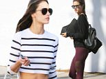 Alessandra Ambrosio shows off toned tunny in striped top after lunch. Monday, November 16, 2015. X17online.com