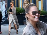 11/15/15 NYC - Mom to be Chrissy Teigen is seen in Soho wearing earth tone color outfit with a skirt with slit revealing her legs with laced heels; stepping out with her mom Vilailuck Teigen, in which later Chrissy attemtps to pull a locked door of an office building on Sunday November 15th, 2015. Non Exclusive / Luis Yllanes / Splash News\n\nPictured: Chrissy Teigen, Vilailuck Teigen\nRef: SPL1173518  151115  \nPicture by: Luis Yllanes / Splash News\n\nSplash News and Pictures\nLos Angeles: 310-821-2666\nNew York: 212-619-2666\nLondon: 870-934-2666\nphotodesk@splashnews.com\n